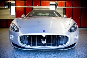 red cabinets in garage with a Maserati