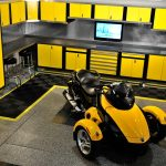 yellow cabinet set up with three wheel motorcycle
